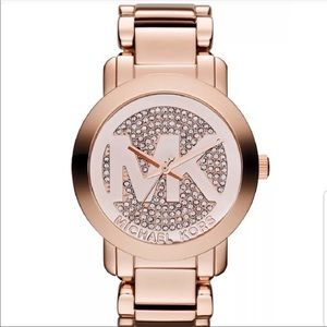 Michael Kors rose gold watch w/crystals on face.